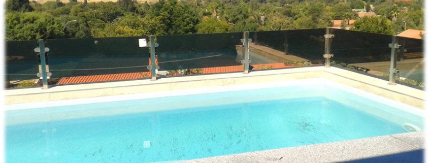 Bronze Glass Balusters Around Swimming Pool No Toprail Arstel